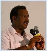 Prabhu at microphone